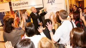 trade show booth magician entertains