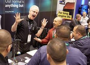 Corporate Magician entertains at ExxonMobil trade show booth.