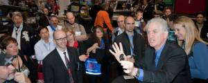 trade show magician does watch trick in Chicago
